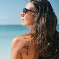 person beach tattoo