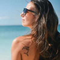 person beach tattoo